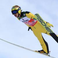 Noriaki Kasai makes a practice jump during an event in Oberstdorf, Germany, on December 29, 2017. Kasai secured his spot at an eighth straight Winter Olympics on Saturday.   AFP-JIJI