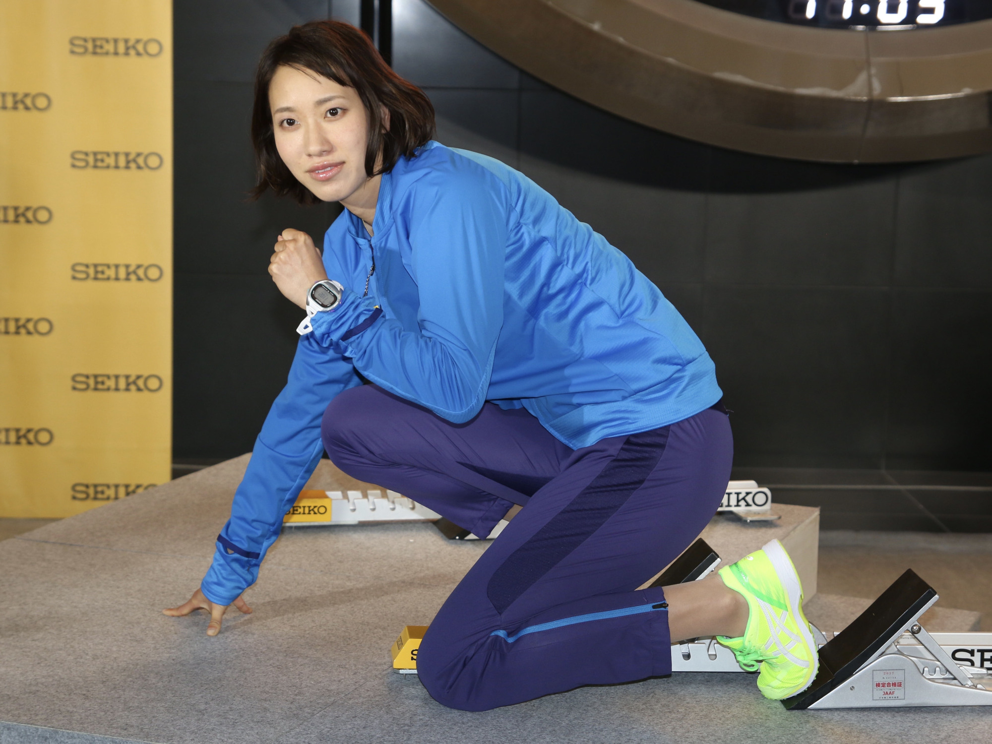 Chisato Fukushima, the national record-holder in the women's 100 and 200 meters, poses for photographers at a news conference in Tokyo on Thursday. | KAZ NAGATSUKA
