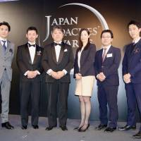 Teikyo University men's rugby team head coach Masayuki Iwade (third from left) and members of the school's medical staff pose for a photo at the Japan Coaches' Awards ceremony in Tokyo on Saturday.   KAZ NAGATSUKA