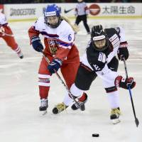 Japan's Chiho Osawa chases the puck with the Czech Republic's Vera Horakova in pursuit during Tuesday's exhibition game in Tokyo. | KAZ NAGATSUKA