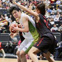 Sunflowers center Yuka Osaki competes with Antelopes players underneath the basket during an All-Japan Championship women's semifinal contest on Saturday at Saitama Super Arena. JX-Eneos cruised past Toyota 78-52. | KAZ NAGATSUKA