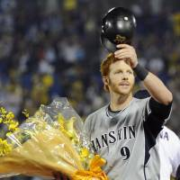 Hanshin's Matt Murton salutes the crowd at Jingu Stadium during this October 2010 file photo. | KYODO