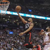 Toronto's Norman Powell flies in for a layup against Cleveland's Tristan Thompson on Thursday. | USA TODAY / VIA REUTERS