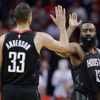Houston's James Harden high-fives teammate Ryan Anderson during the Rockets' 114-107 win over the Magic on Tuesday. | AP