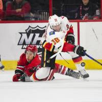 Flames beat Hurricanes for seventh straight win