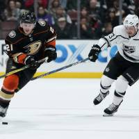 The Ducks' Chris Wagner controls the puck as the Kings' Kyle Clifford defends in the first period on Friday in Anaheim, California. | KELVIN KUO / USA TODAY / VIA REUTERS