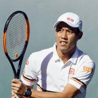 Kei Nishikori plays a shot during his 6-3, 3-6, 6-4 loss to Dennis Novikov at the Newport Beach tournament on Tuesday. | KYODO