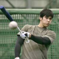 Shohei Ohtani works out on Friday in preparation for the upcoming season. | KYODO
