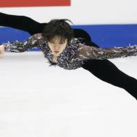 Shoma Uno performs his short program at the Four Continents Championships on Thursday in Taipei. Uno leads the competition with 100.49 points. | KYODO
