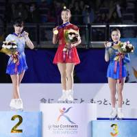 Kaori Sakamoto (center), Mai Mihara (left) and Satoko Miyahara finished 1-2-3 in the women's competition at the Four Continents Championships on Friday in Taipei. | KYODO