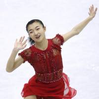 Kaori Sakamoto competes in the women's free skate on Friday in Taipei. Sakamoto captured the Four Continents title with 214.21 points. | KYODO