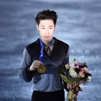 Gold medalist Jin Boyang of China is seen during the victory ceremony on Saturday. Jin amassed 300.95 points to nab the title. | AFP-JIJI
