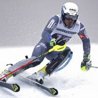 France's Victor Muffat-Jeandet competes in the slalom portion of a World Cup combined race in Wengen, Switzerland, on Friday. Muffat-Jeandet won in a time of 2 minutes, 35.29 seconds. | REUTERS