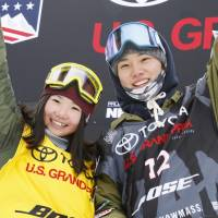 Reira Iwabuchi (left) and Hiroaki Kunitake celebrate after Friday's slopestyle World Cup events in Aspen, Colorado. | KYODO