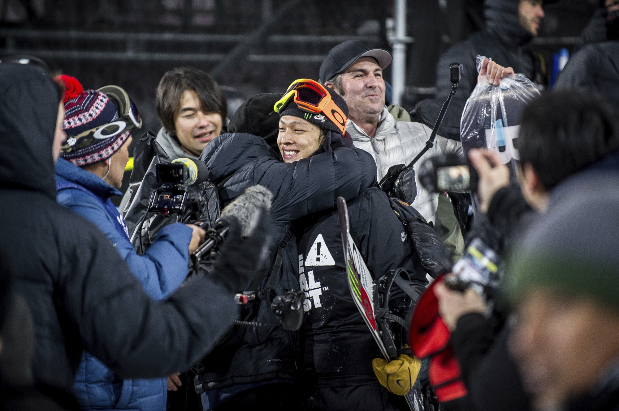 Ayumu Hirano (center) is congratulated after winning the superpipe final at the Winter X Games on Sunday in Aspen, Colorado.   AP