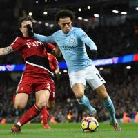 Man City eases past Watford to restore lead to 15 points