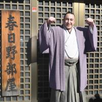 Tochinoshin poses outside the Kasugano Stable in Tokyo's Sumida Ward on Monday. | KYODO