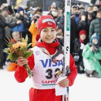 Sara Takanashi poses for pictures after finishing third at a World Cup ski jumping meet in Sapporo on Saturday. | KYODO