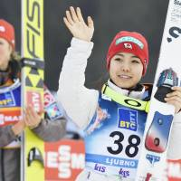 Sara Takanashi waves to the crowd after finishing third at a World Cup ski jumping event in Ljubno, Slovenia, on Saturday. | KYODO