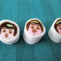 Kintaro ame is a traditional candy in a cylindrical shape, originating during the Edo Period and often representing a picture of legendary hero Kintaro as a child. After being sliced, the cylinder's cross-section shows an almost exact replica of Kintaro's face. | makiko itoh