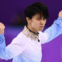 Yuzuru Hanyu strikes a pose in the men's single skating short program of the figure skating event. | AFP-JIJI