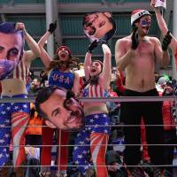 Fans of the USA cheer in the team relay competition luge final at the Olympic Sliding Centre. | AFP-JIJI