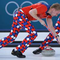 Norway's Christoffer Svae brushes in front of the stone during the curling men's round robin session between Norway and South Korea. | AFP-JIJI
