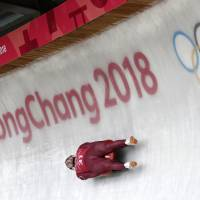 Russian athlete Stepan Fedorov speeds past the Olympic rings during the men's luge training run ahead of the 2018 Winter Olympics on Friday. | AP