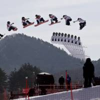 In this multiple exposure image Yuka Fujimori, of Japan, jumps during qualification for the women's big air snowboard competition on Monday.   AP