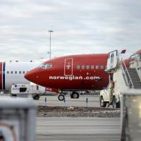 Boeing 737-800 aircraft belonging to budget carrier Norwegian Air stand at Stockholm Arlanda Airport in 2015. | JOHAN NILSSON / TT NEWS AGENCY / FILE PHOTO / VIA REUTERS