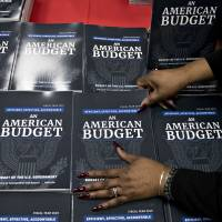 Copies of U.S. President Donald Trump's fiscal 2019 budget request, An American Budget, are placed on display at the U.S. Government Publishing Office (GPO) library in Washington on Monday. Trump will propose cutting entitlement programs by $1.7 trillion, including Medicare, in a fiscal 2019 budget that seeks billions of dollars to build a border wall, improve veterans health care and combat opioid abuse and that is likely to be all but ignored by Congress. | BLOOMBERG