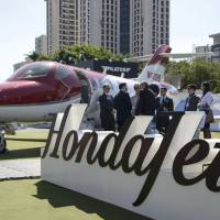 A HondaJet HA-420 is displayed at the Latin American Business Aviation Conference and Exhibition in Sao Paulo in 2015. Honda Aircraft Co. sees major prospects in China and Southeast Asia as wealthy individuals seek out the lightweight plane. | BLOOMBERG