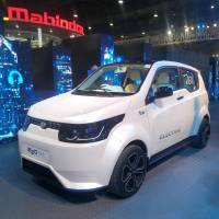 An electric car is displayed Feb. 7 by automaker Mahindra & Mahindra Ltd. in Greater Noida, India. | KYODO
