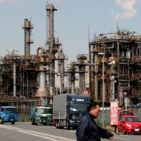 Japan lowers assessment as January industrial output falls 6.6%