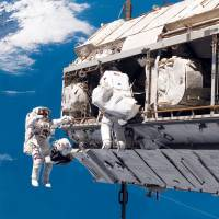 Astronaut Robert L. Curbeam Jr. (left) and European Space Agency astronaut Christer Fuglesang participate in a 2006 space walk during construction of the International Space Station. Under President Donald Trump's 2019 proposed budget released, Monday, U.S. government funding for the space station would cease by 2025. | NASA / VIA AP
