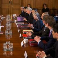 Britain's Prime Minister Theresa May hosts a roundtable meeting with senior representative from Japanese companies at No. 10 Downing St. in London on Thursday. | REUTERS