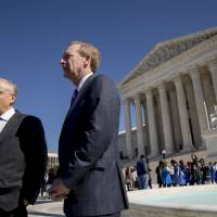 Attorney Josh Rosenkranz (left), accompanied by his client, Microsoft President and Chief Legal Officer Brad Smith, speaks to reporters outside the Supreme Court Tuesday in Washington. The Supreme Court heard arguments Tuesday in a dispute between the Trump administration and Microsoft Corp. over a warrant for emails that were sought as part of a drug trafficking investigation. | AP