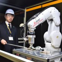 Mitsubishi Electric shines spotlight on new AI technology at R&D event