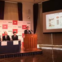 Representatives from JTB Corp., Microsoft Japan Co. and Navitime Japan Co. announce the launch of the Japan Trip Navigator app on Thursday at a hotel in Tokyo. | KAZUAKI NAGATA