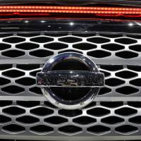 Nissan Motor Co. Thursday lowered its operating profit forecast for this fiscal year because of an inspection scandal that came in light in 2017. | REUTERS