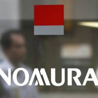 The Nomura Securities Co. logo is displayed on a door at the company's branch in Tokyo. Nomura Holdings Inc. has issued an apology after investors in a $300 million product betting on low volatility were all but wiped out during this week's stock market turmoil. | BLOOMBERG