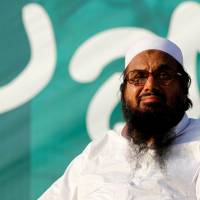 Hafiz Muhammad Saeed, chief of the banned Islamic charity Jamat-ud-Dawa, looks over the crowed as they end a 'Kashmir Caravan' from Lahore with a protest in Islamabad in 2016. | REUTERS