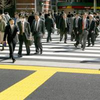 A monthly Reuters Corporate Survey shows that more than half of Japanese companies have no plans to raise wages. | BLOOMBERG