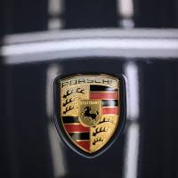 The Japanese subsidiary of German luxury automaker Porsche says it has detected multiple cyberattacks that resulted in over 28,700 customer email addresses being stolen. | BLOOMBERG
