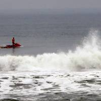 A rescue workers rides a personal water scooter during searches for the chief executive of sportswear maker Quiksilver Pierre Agnes, in Hossegor, southwestern France, Wednesday.   AP