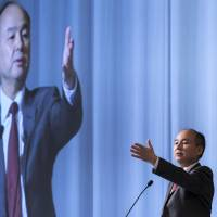 Masayoshi Son, chairman and chief executive officer of SoftBank Group Corp., speaks during a news conference in Tokyo on Wednesday. SoftBank could purchase as much as a third of Swiss Re AG, one of the world's largest reinsurers, sources said. | BLOOMBERG
