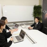Customers use Spacee Inc.'s shared office in Tokyo on Feb. 1. | KYODO