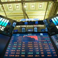 The closing numbers for the Dow Industrial Average are displayed after the closing bell at the New York Stock Exchange on Feb. 5.   AFP-JIJI