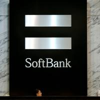 SoftBank's market capitalization is less than half its holdings, but executives at the firm plan to step up efforts to change that. | REUTERS