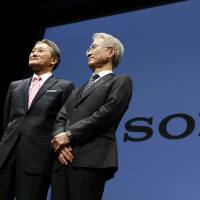 Kenichiro Yoshida (right), set to take over as Sony president, and outgoing chief Kazuo Hirai appear at a Tokyo event on Friday. | AP